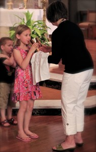 Eucharist Minister w Child