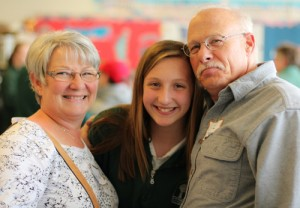 student girl with grandparents